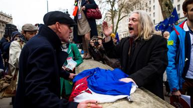 Two men argue at as pro and anti-Brexit protesters meet in Whitehall, London, January 2020
